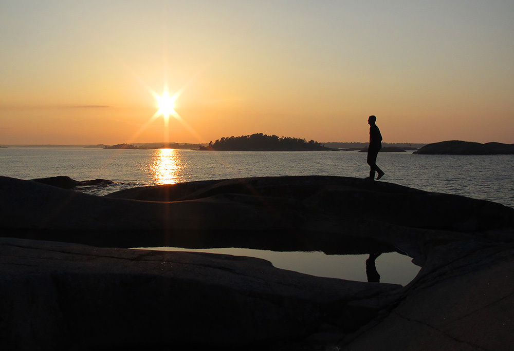 Finafina promenadklippor och solnedgång